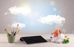 Bright sky with clouds and office desk Stock Photos
