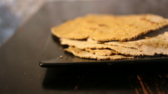 Flatbreads on the black plate Stock Footage