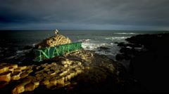 "4k Aerial Shot of a Queen on Giant's Causeway and 3D Animated text ""Nature"" Stock Footage"