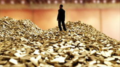 Man on pile of gold bars. business concept Stock Footage