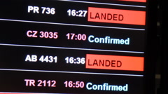 Flight confirmed on information board in airport terminal. Stock Footage