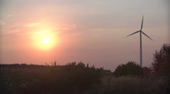 Wind turbines at sunset, green energy Stock Footage