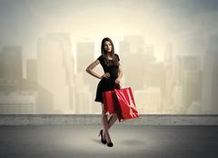 City woman standing with shopping bags Stock Photos