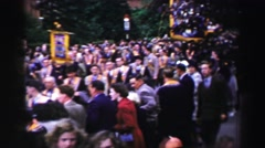1952: the scene shows people overlooking a parade in the go and seem very happy Stock Footage