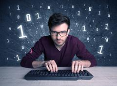 Online intruder geek guy hacking codes Stock Photos