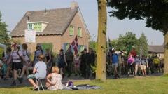 Vierdaagse walkers pass through village,Middelaar,Netherlands Stock Footage