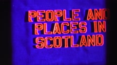 1952: a bright red neon sign referring to people and places in scotland ENGLAND Stock Footage