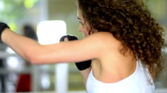 Athletic young curly woman shadow boxing, side view, slow motion Stock Footage