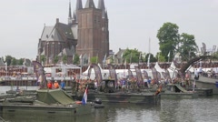 Pontoon bridge and vierdaagse walkers and Martinus church,Cuijk,Netherlands Stock Footage