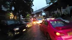 Riding motorcycle through flood water in Bangkok, Thailand. Stock Footage