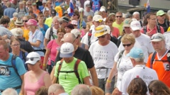 Vierdaagse walkers pass over pontoon bridge,Cuijk,Netherlands Stock Footage