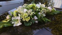 Close up of black car festively decorated with white flowers Stock Footage