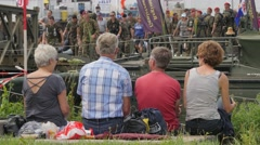 People watching vierdaagse walkers on pontoon bridge,Cuijk,Netherlands Stock Footage