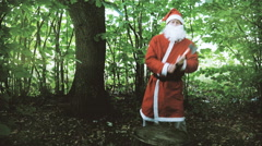 Early Autumn Santa Dancing With an ax and Chop a Piece of Wood Stock Footage