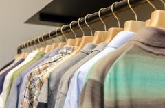 Various Men's Clothing On A Wooden Hanger. CloseUp shot with small GRIP. Stock Photos