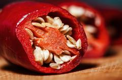 Fresh Red Hot Pepper Slices Cut On An Old Wooden Board. Macro. Stock Photos