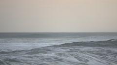 An angry foamy wave crashes near beach Stock Footage