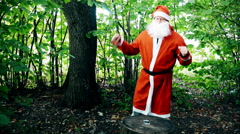 Early Autumn Santa Dancing in the Woods With Your Phone Stock Footage