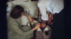 1955: little boy getting all dressed up as a cowboy PENNINGTON, NEW JERSEY Stock Footage