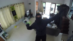 Funny Thief Dancing in Front Of Camera While Stealing House Stock Footage