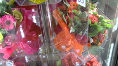 Differently Decorated Bouquets Turning in Flower Shop Show Case. Close up Stock Footage