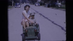1955: boy riding in car with mom PENNINGTON, NEW JERSEY Stock Footage