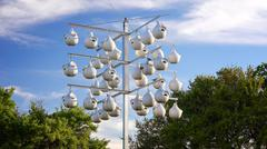 White Gourd Bird Houses Hanging From Pole Stock Photos