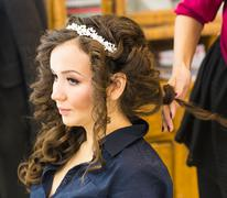 Hair stylist makes the bride before a wedding Stock Photos