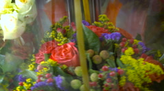 Round Turning Show Case With Flower Bouquets Inside. Close up Stock Footage