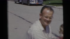 1955: man and child riding in toy jeep car on suburban street PENNINGTON, NEW Stock Footage