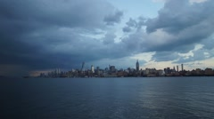 Storm Clouds Passing over Midtown Manhattan with a Rainbow and Lightning Stock Footage