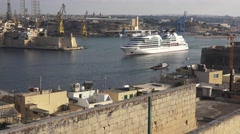 SEABOURN SOJOURN CRUISE LINER LEAVING MALTA HARBOUR Stock Footage