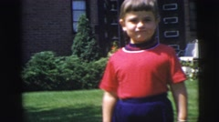 1955: pretty little girl showing off for the camera in front of her house Stock Footage