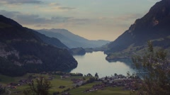 Switzerland small village by the high mountains and deep blue lake. High peaks Stock Footage