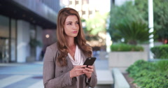 Pretty Businesswoman intern using smartphone to communicate team members Stock Footage