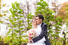 Newly married couple in autumn park Stock Photos