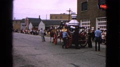 1963: crowd gathered on the side of the street to watch a horse drawn cart Stock Footage