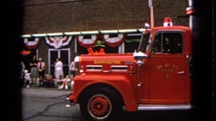 1963: a fire brigade is seen passing in a parade BARRINGTON, ILLINOIS Stock Footage