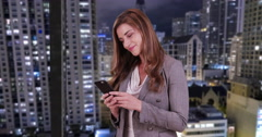 Attractive Businesswoman intern using smartphone to communicate team members Stock Footage