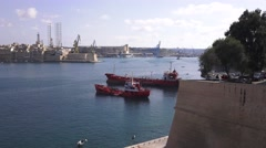 TWO RED BOATS IN VALLETTA HARBOUR MALTA Stock Footage