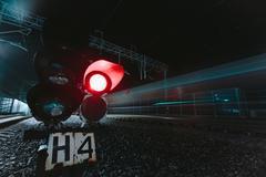 Red semaphore railway night Stock Photos