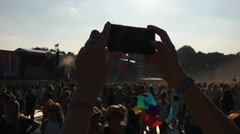 Closeup of Woman Filming With Cellphone at Summer Music Festival Stock Footage