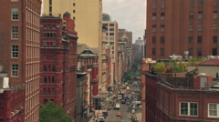 Slow zoom in on busy NY street Stock Footage