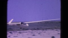 1964: white aircraft safely landing on runway in the desert ELMIRA, NEW YORK Stock Footage