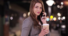 Sexy businesswoman talking on smartphone when she recognizes a friend off Stock Footage