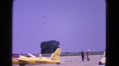 1964: the scene shows an aircraft preparing for take off and people are seen Stock Footage