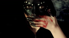 4k Halloween Shot of a Creepy Woman Wiping with Blood on Hands Stock Footage
