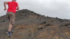 Alone runner runs to the summit of the volcano Stock Footage