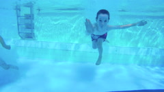 Young kids jumping to a swimming pool Stock Footage