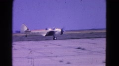 1964: various smalls planes with propellers and wings taking off and landing Stock Footage
